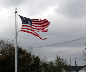 American flag stands tall, but tattered, after Superstorm Sandy