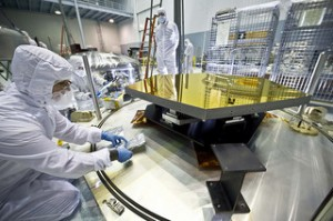 NASA engineers test mirror components of the agency's Webb Telescope.