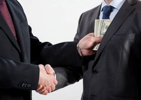 Giving bribe into a pocket