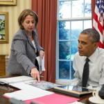 Lisa Monaco confers with President Obama.