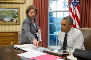 Lisa Monaco confers with President Obama.