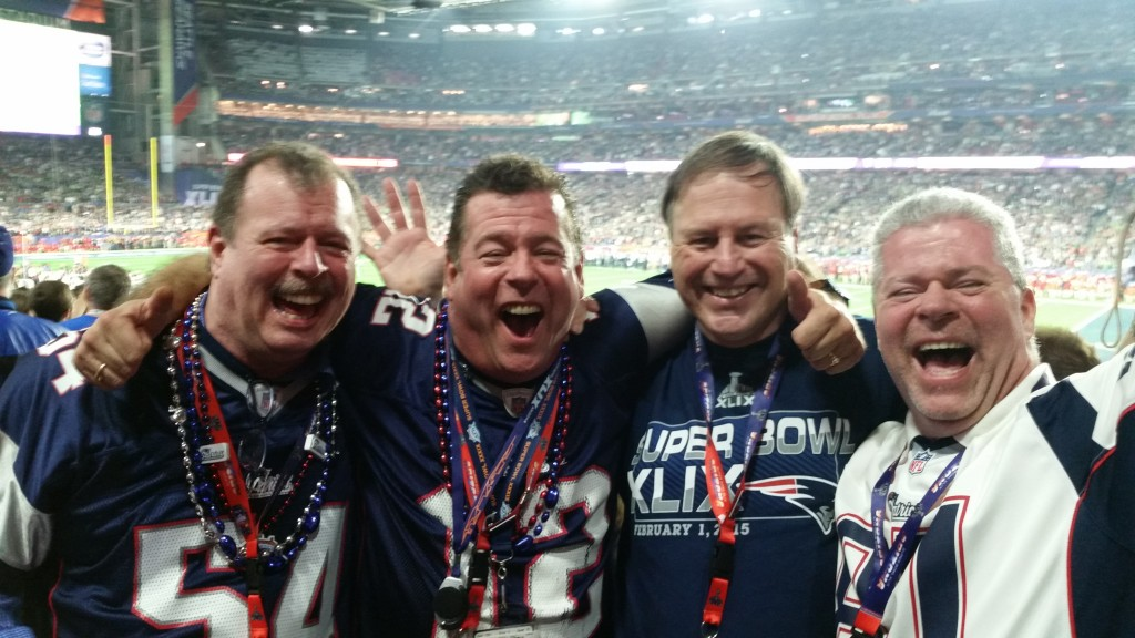 Super-fan Kelly, left, with two brothers and a friend at Super Bowl XLIX, 30 seconds after the Patriots' victory.