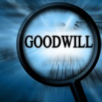 goodwill on a blue background with a magnifier