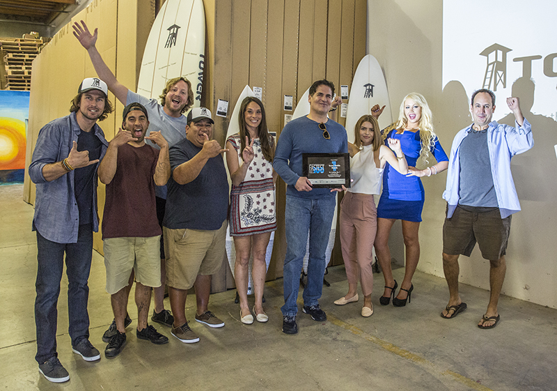 Aarstol, far right, with Mark Cuban and Tower Paddleboards' workforce