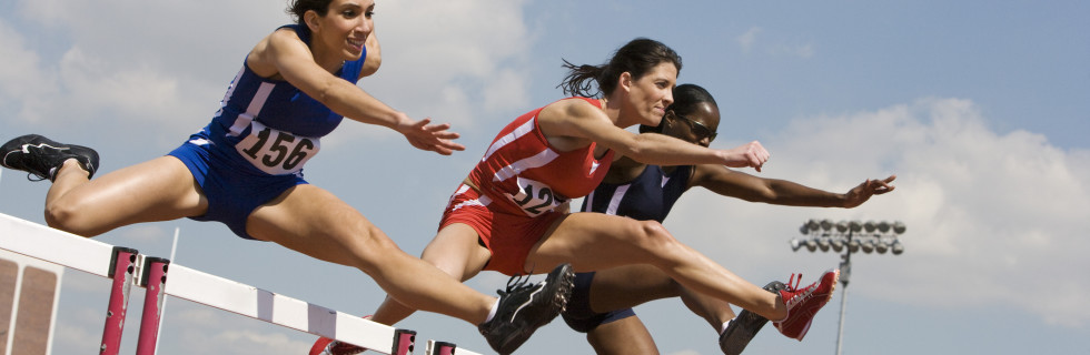 Female athletes hurdling