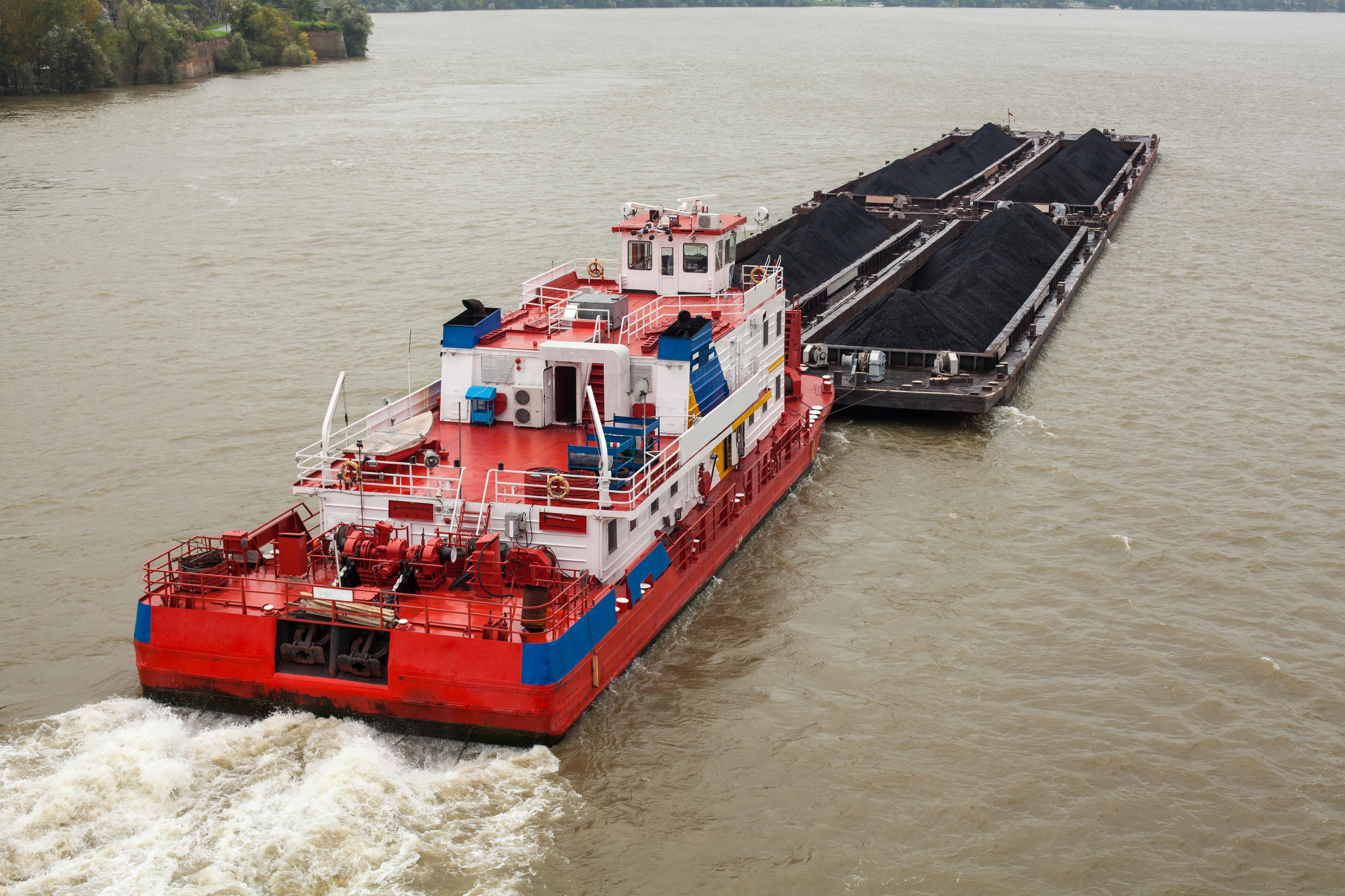 Tugboat Pushing a Heavy Barge
