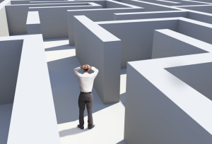 Rear view of businessman standing in maze