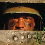 Male Soldier Staring Out Of Bunker