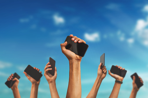 group of hands holding mobile phones